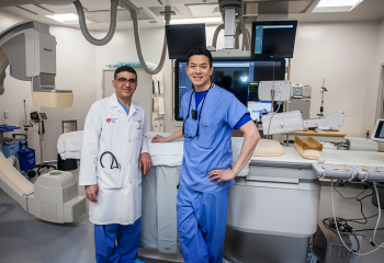 Dr. Hussein Beydoun (left) and Dr. Tony Lee (right) in Cardiac Cath Lab D.