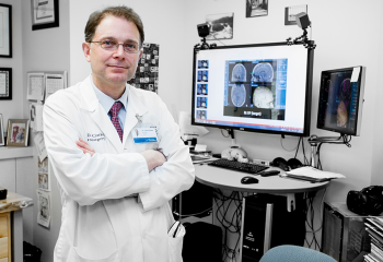 Dr. David Clarke, head of the division of neurosurgery at the QEII, stands in front of the StealthStation. This new technology enables neurosurgeons to carry out surgery more effectively, efficiently and in a way which is ultimately safer for the patient.
