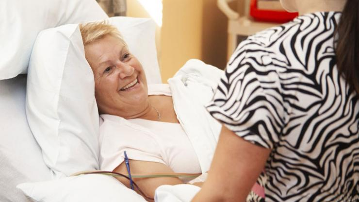 Patient smiling with a nurse at the QEII Cancer Centre