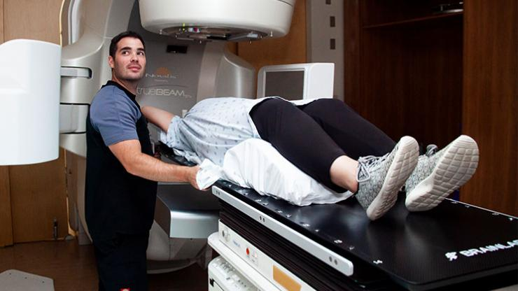 A patient getting radiation screening on a linear accelerator at the QEII