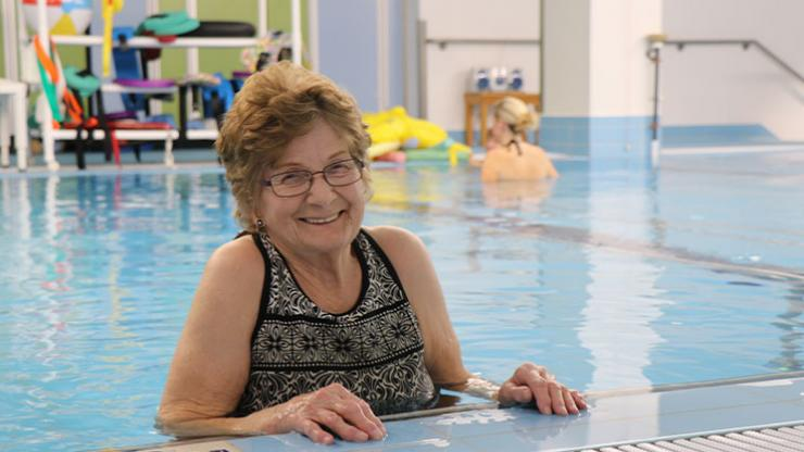 Marilyn Callohan receiving warm-water aquatic therapy in the  The Grace Hansen Therapeutic Pool.