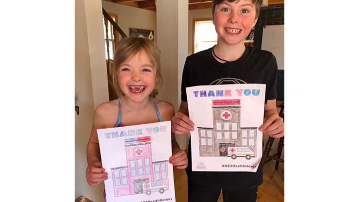 Logan and Nora from Hubbards showing their #QE2HealthHeroes appreciation!