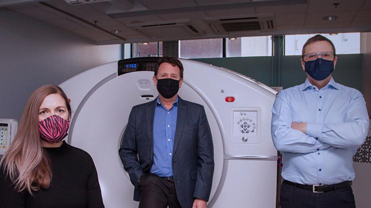 Left to right: Sharon Needham(neuroendocrine cancer patient), Dr. Daniel Rayson and Dr. Steven Burrell in front of the donor-funded PET-CT.