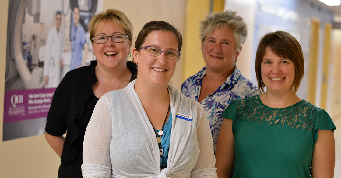 As part of the Interprofessional Practice and Learning team at the QEII, Shawna Hudson (left), Angeline Comeau (front), Jane Allen (back) and Andrea Goldstein (right), engage with clinical and support teams to help lay the foundation for collaborative learning for healthcare professionals to promote quality care for patients.