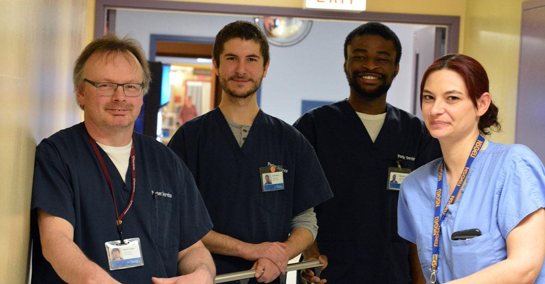 Kevin Crain (left), Sam Baker (centre left), Nnamdi Umahi (centre right) and Mish Manette (right) are part of the team of porters at the QEII.