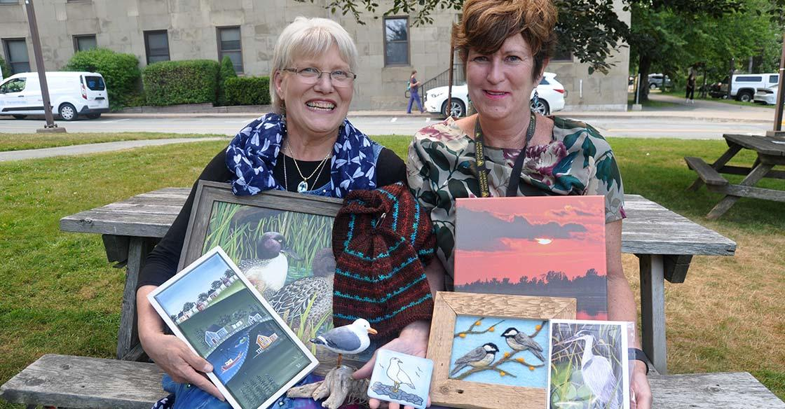 Mary Nowee of Not Me Art Gallery, and Meg McCallum, artist and QEII staff member